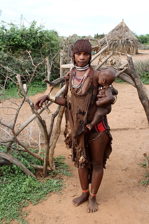 A woman from the Hamar tribe with her baby