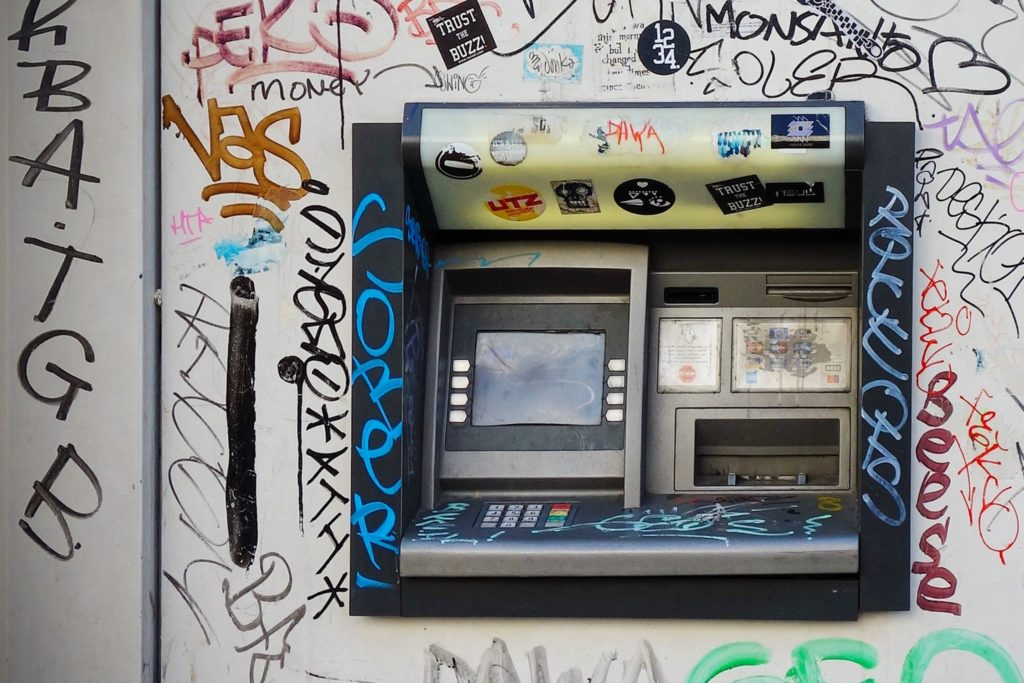 ATM covered in graffiti