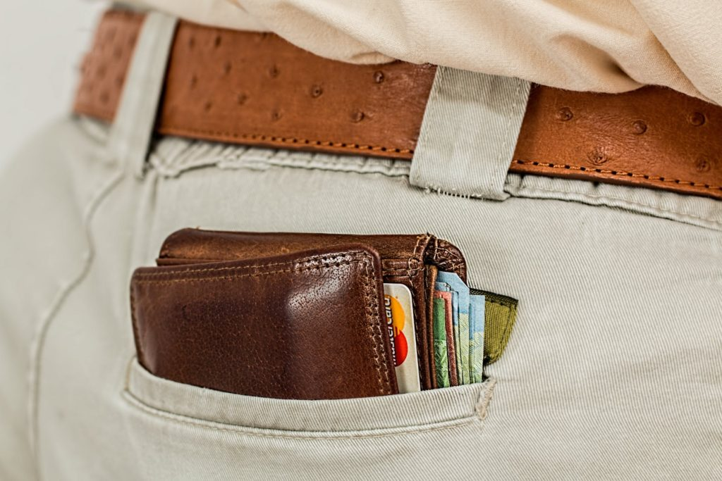 A man carrying his wallet in his back pocket where a pickpocket can easily access it