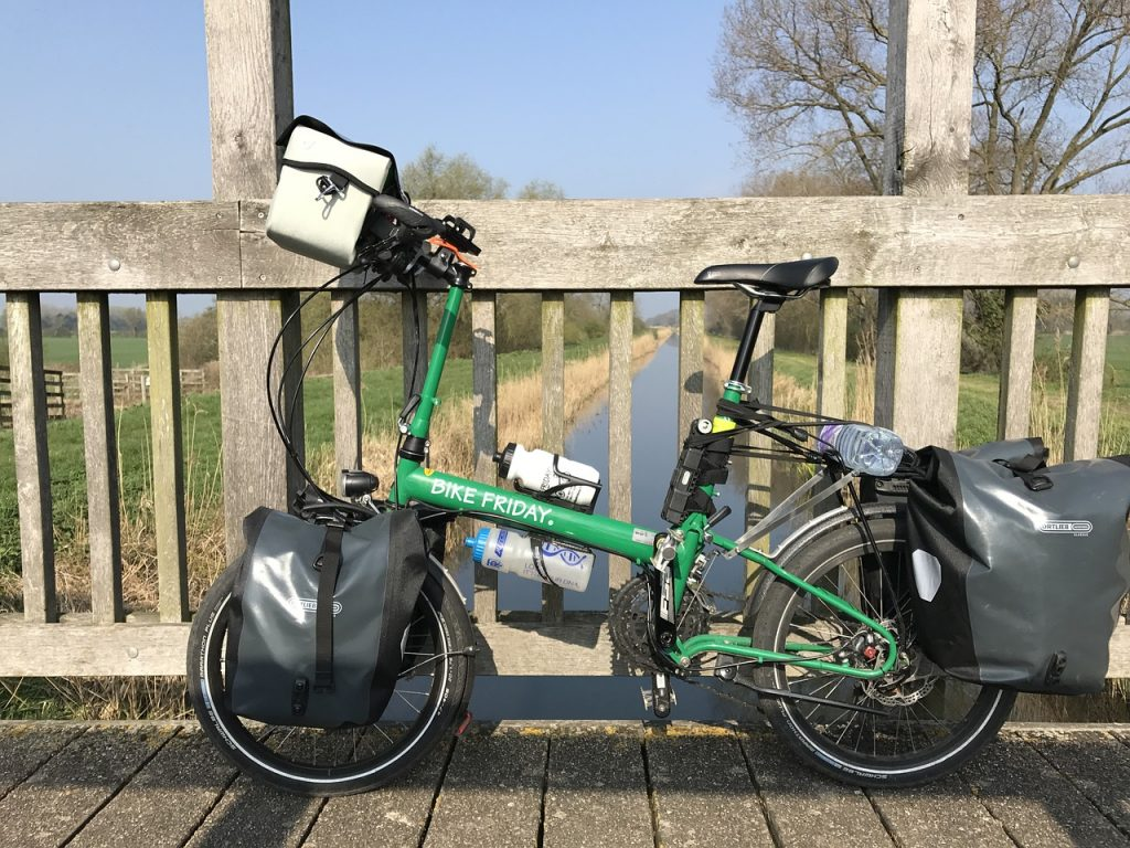 Folding touring bike with panniers