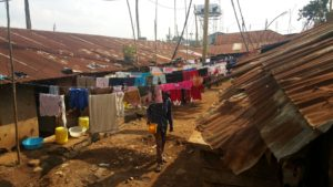 clothes hanging between houses in Kibera, Nairobi