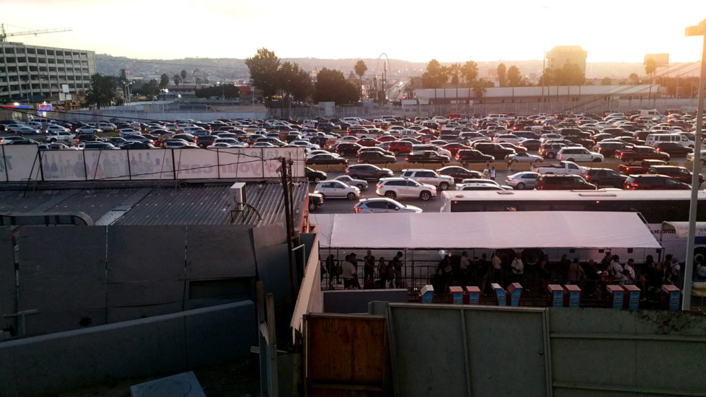 line of cars waiting to cross back to the US at the Tijuana border