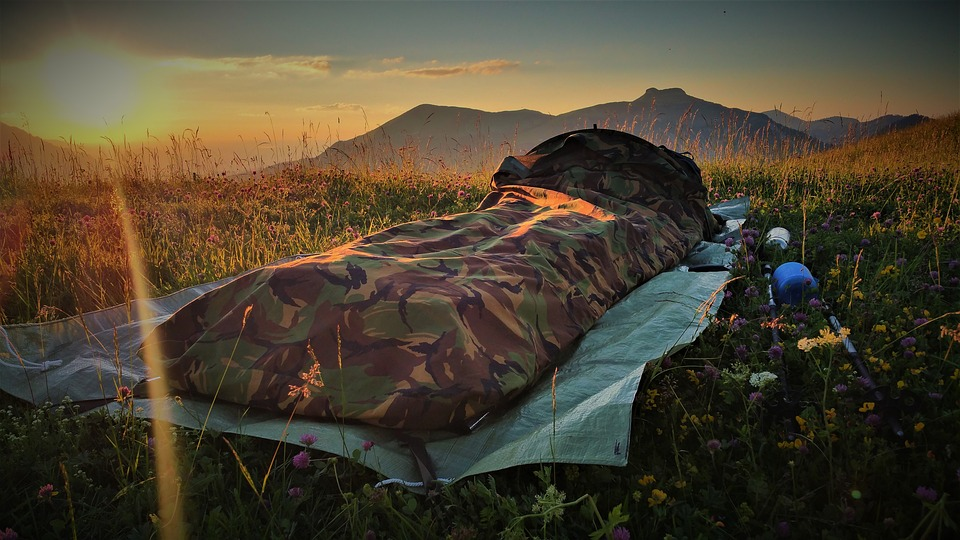 a bivy sack set up in a field