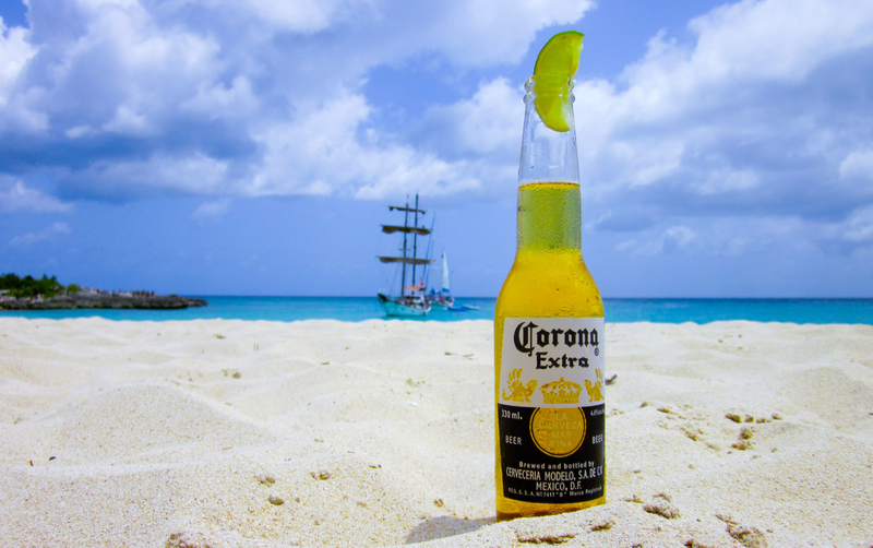 Corona with lime on the beach