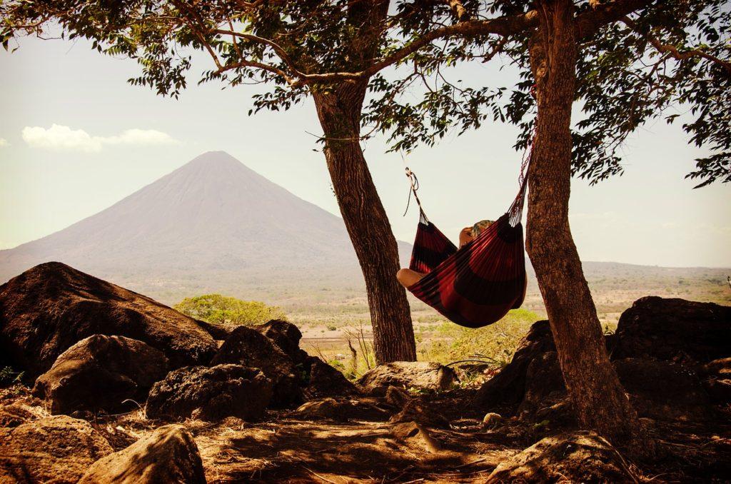 a man laying in a hammock