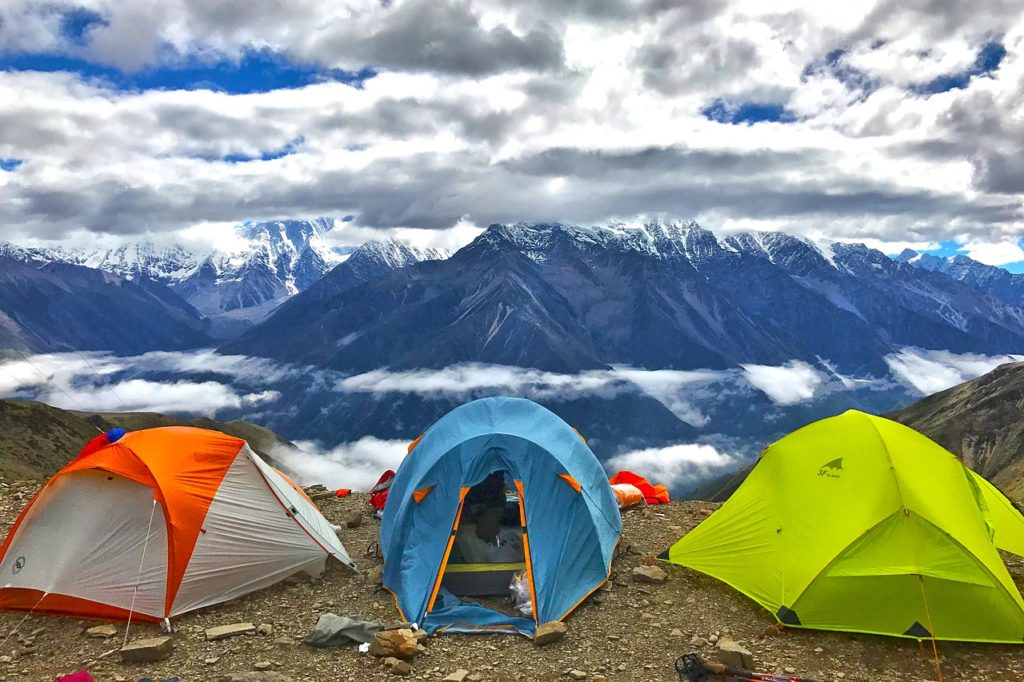 three tents in the mountains