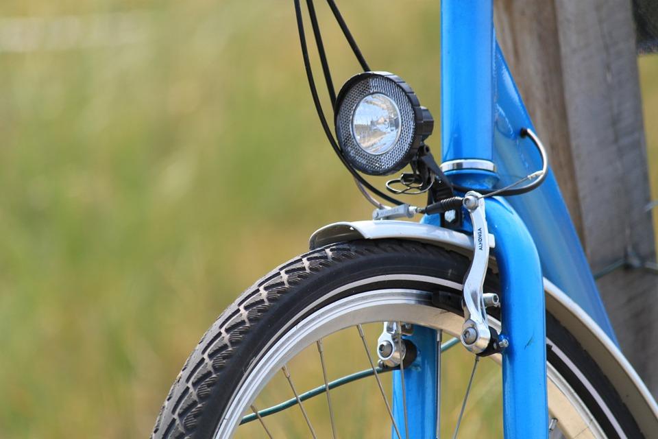Front rim brake on a blue bike
