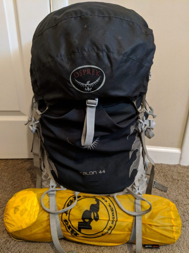 tent strapped to backpack