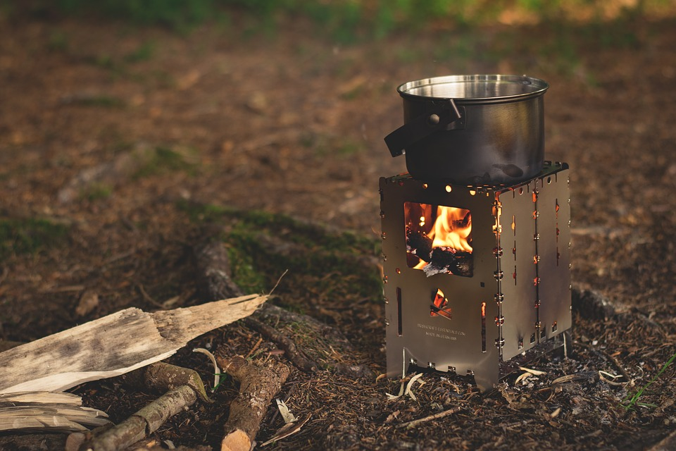 Cooking over a wood camp stove