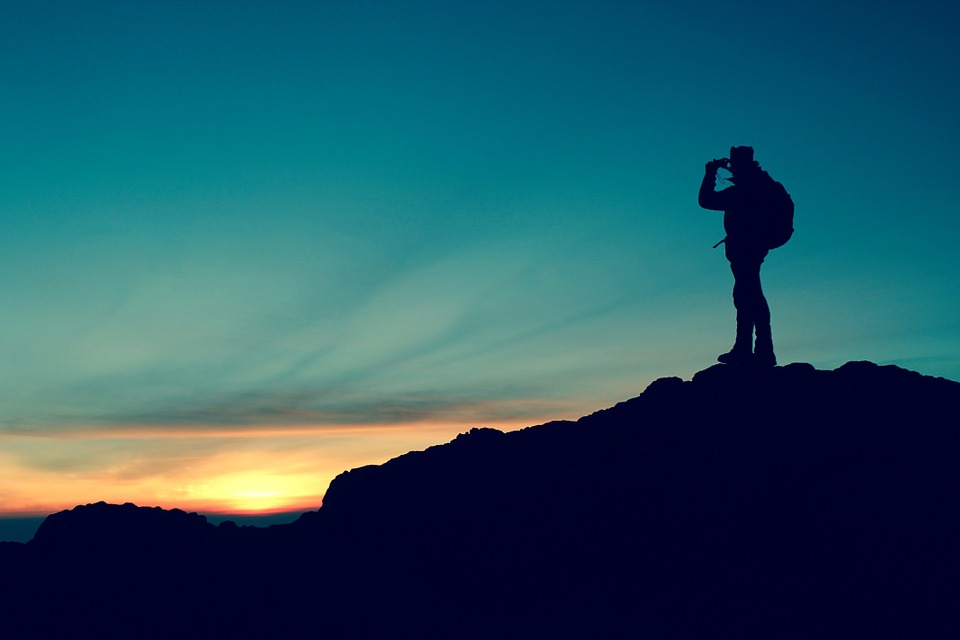 A solo traveler standing on a hill