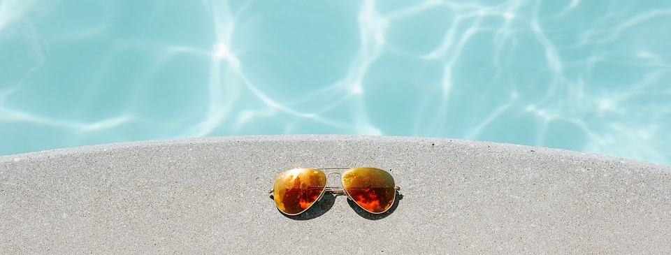 Sunglasses sitting by the pool