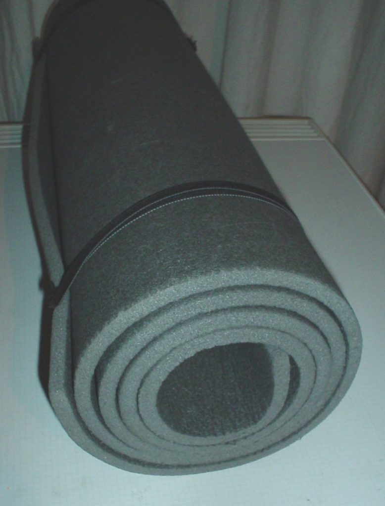 a basic foam sleeping pad rolled up