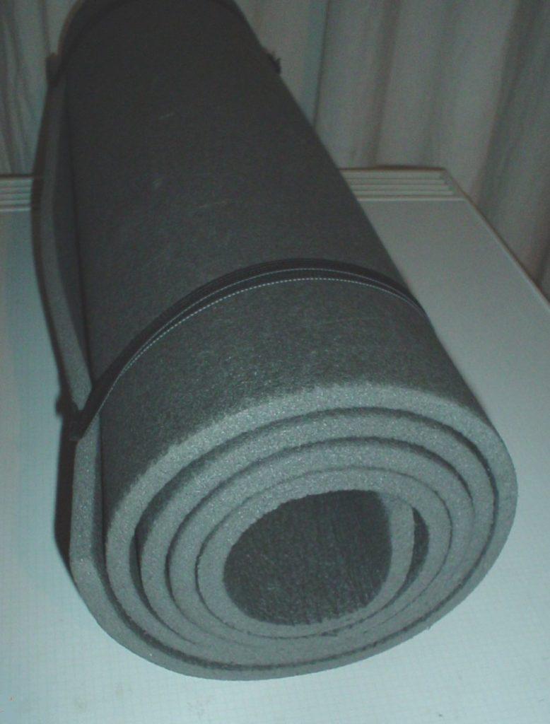 a basic foam sleeping pad rolled up