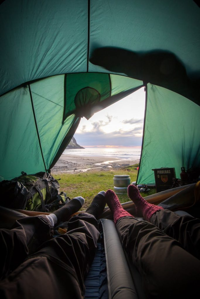 A couple laying inside of a tent