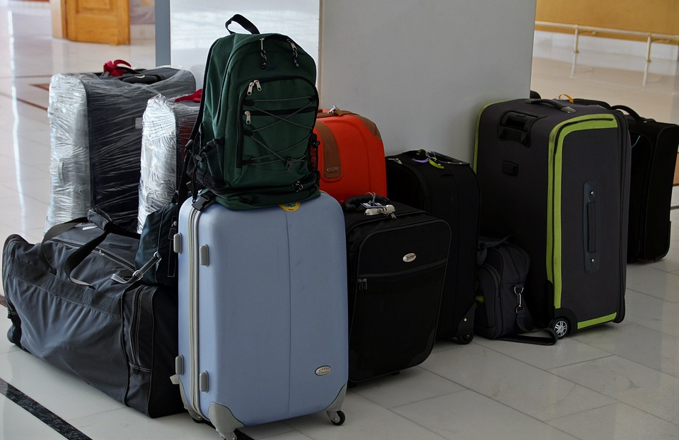Suitcases sitting around an airport