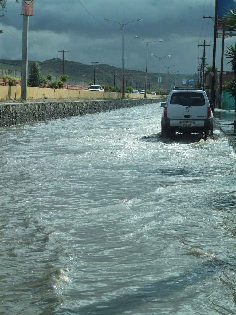 Driving down a flooded Tijuana street after a heavy rain