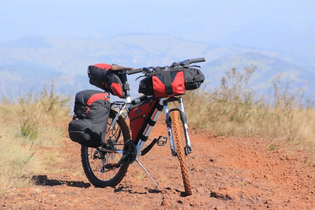 a touring bike with bikepacking bags and rear panniers