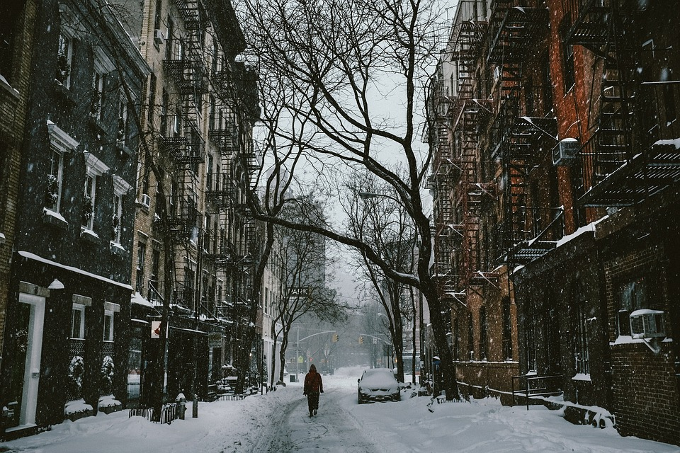 a snowy street in New York in the winter.