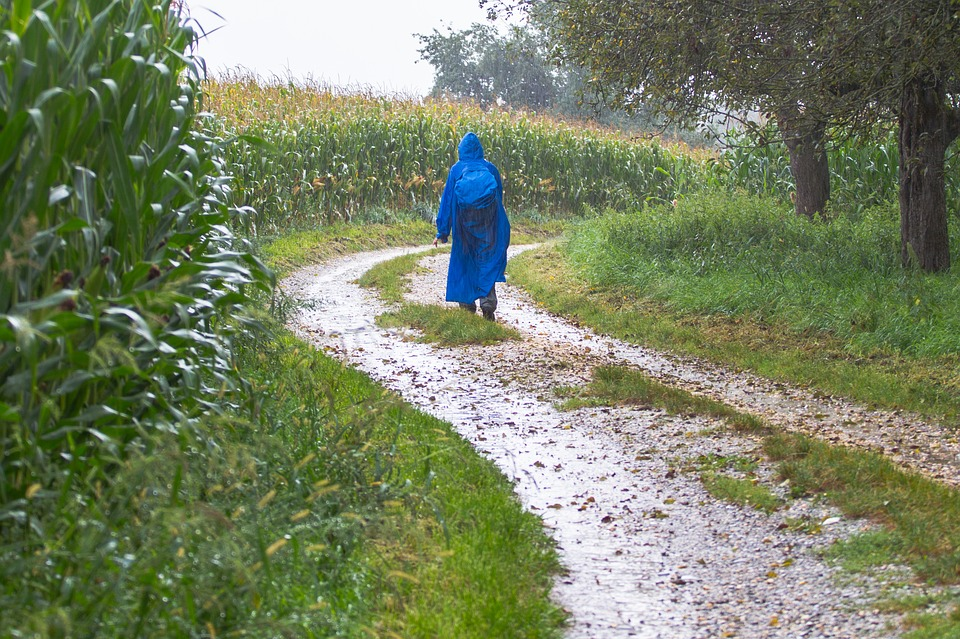 a person hiking while wearing a rain poncho
