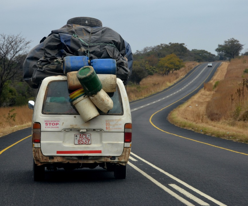 Luggage loaded on top of a minibus in Zimbabwe