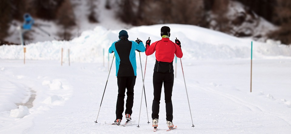 two people skiing in the snow