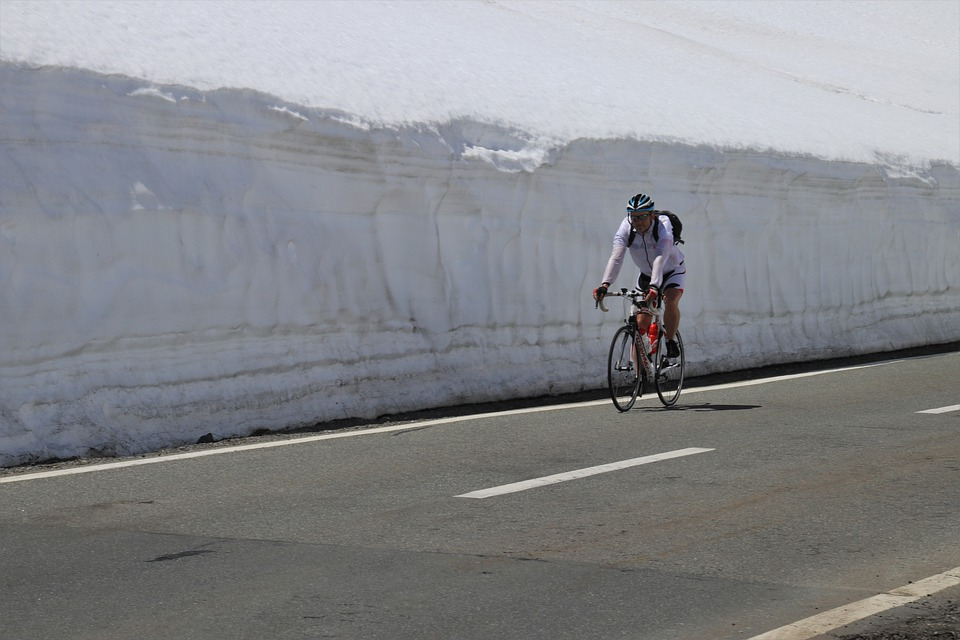 cycling near a large snow wall during the winter