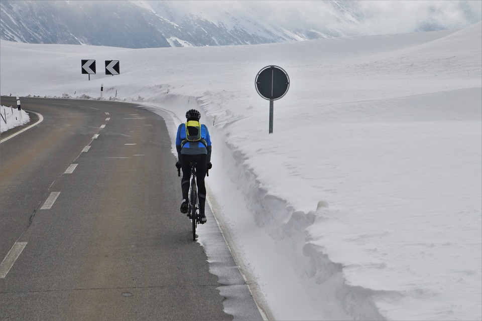 Cycling in the road because the shoulder is covered with snow and ice