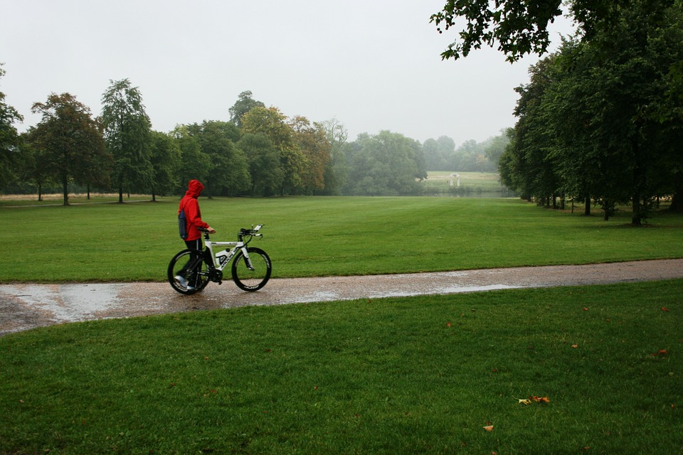 a cyclist wearing a rain jacket
