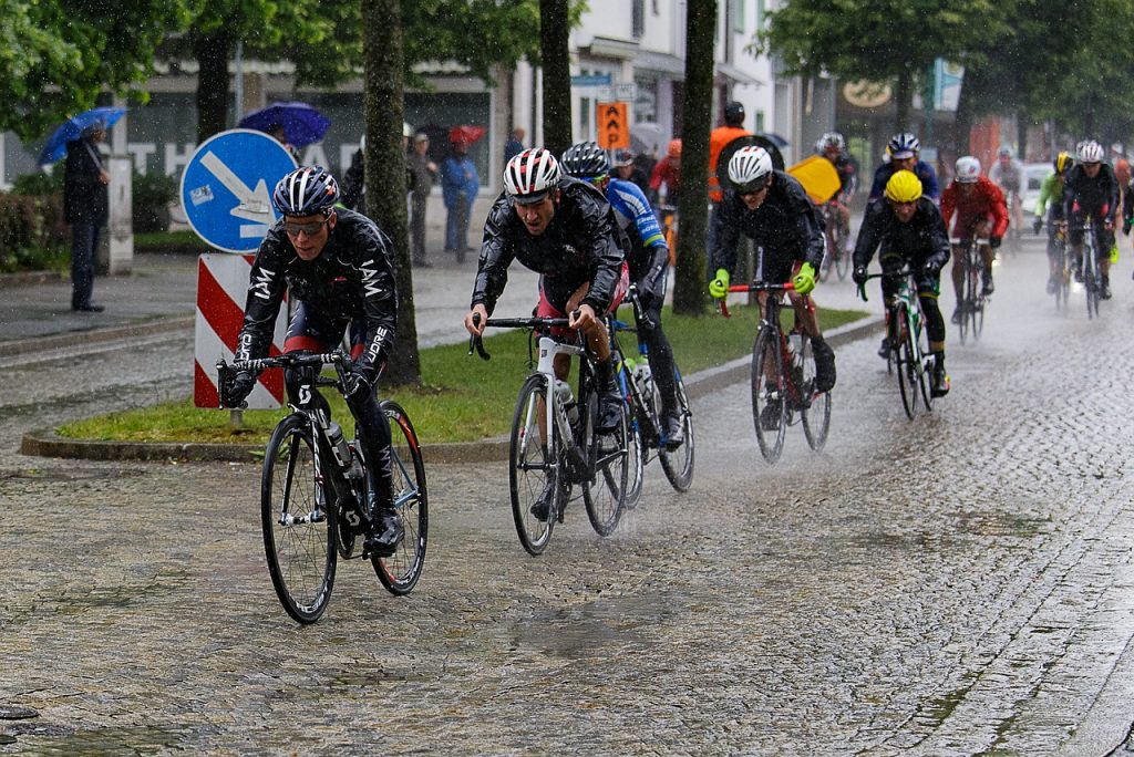 cyclists racing in the rain