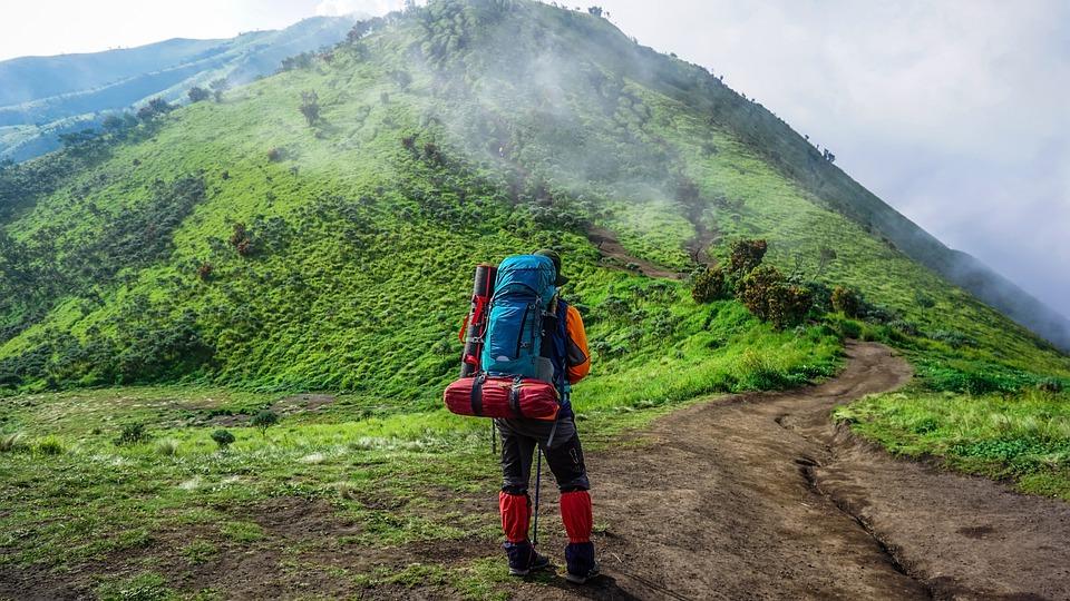A hiker wearing below the knee gaiters