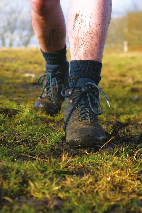 a man wearing hiking boots and socks