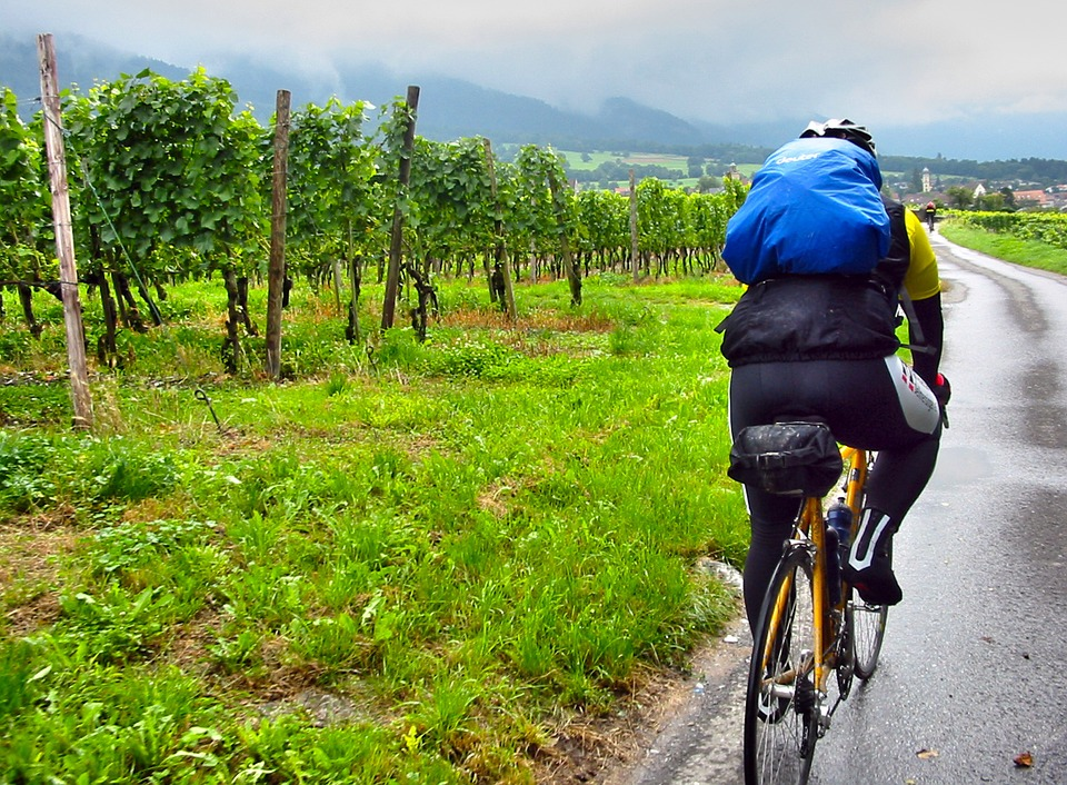 cycling in the rain with a backpack