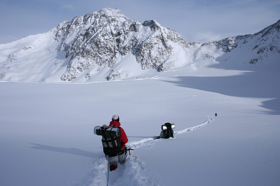 hiking in deep snow in the mountains