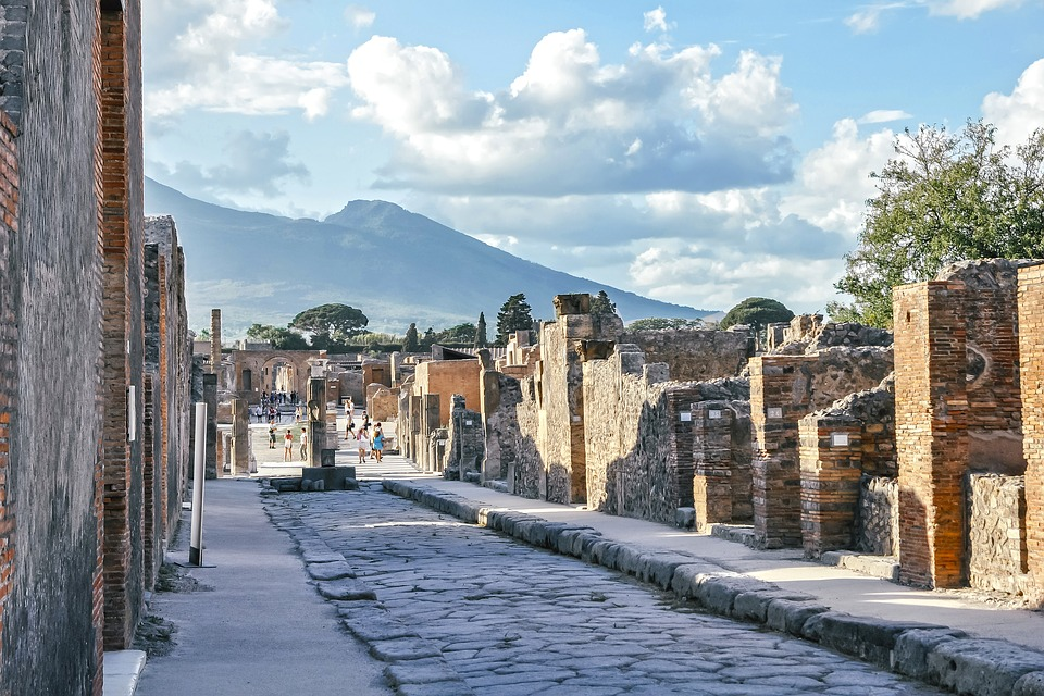A street in Pompeii with Mount Vesuvius in the background