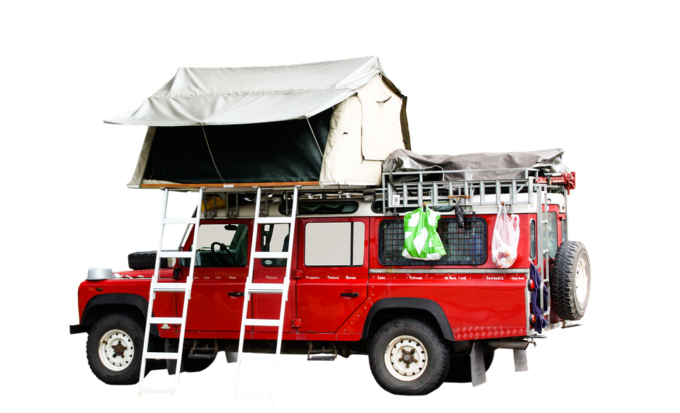 a large soft shell roof top tent on an overlanding vehicle
