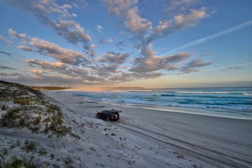 SUV camping on the beach