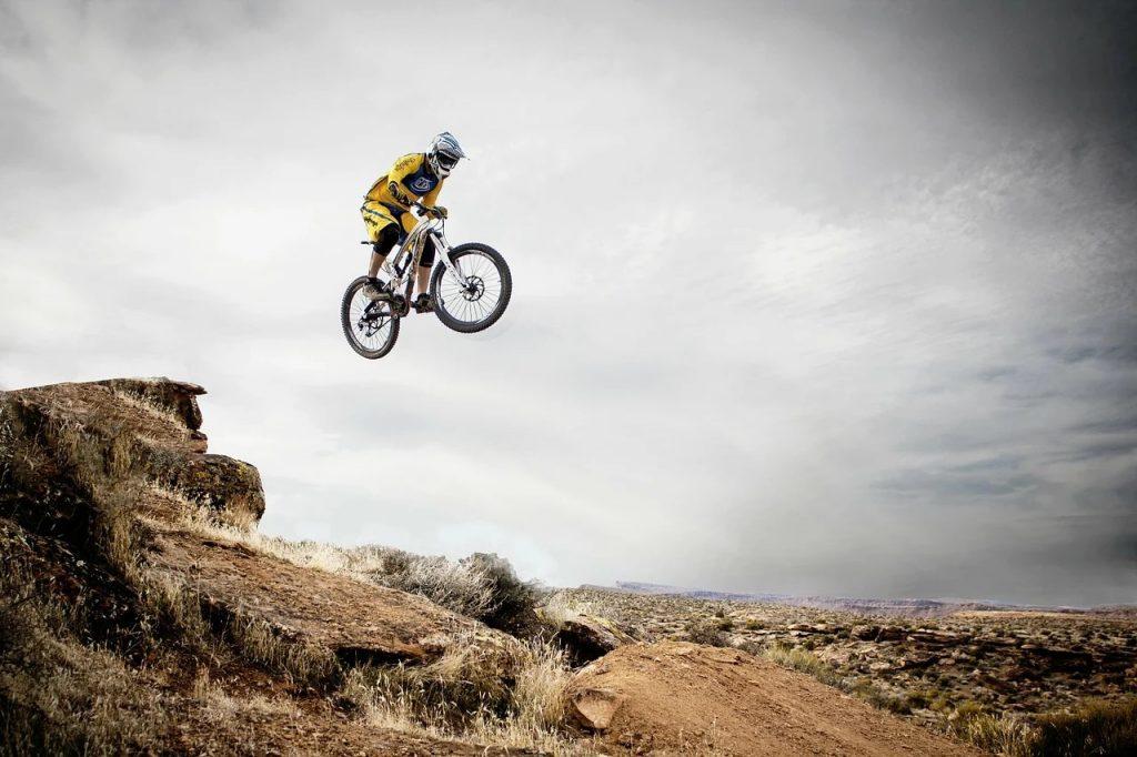 A mountain biker taking a large jump.