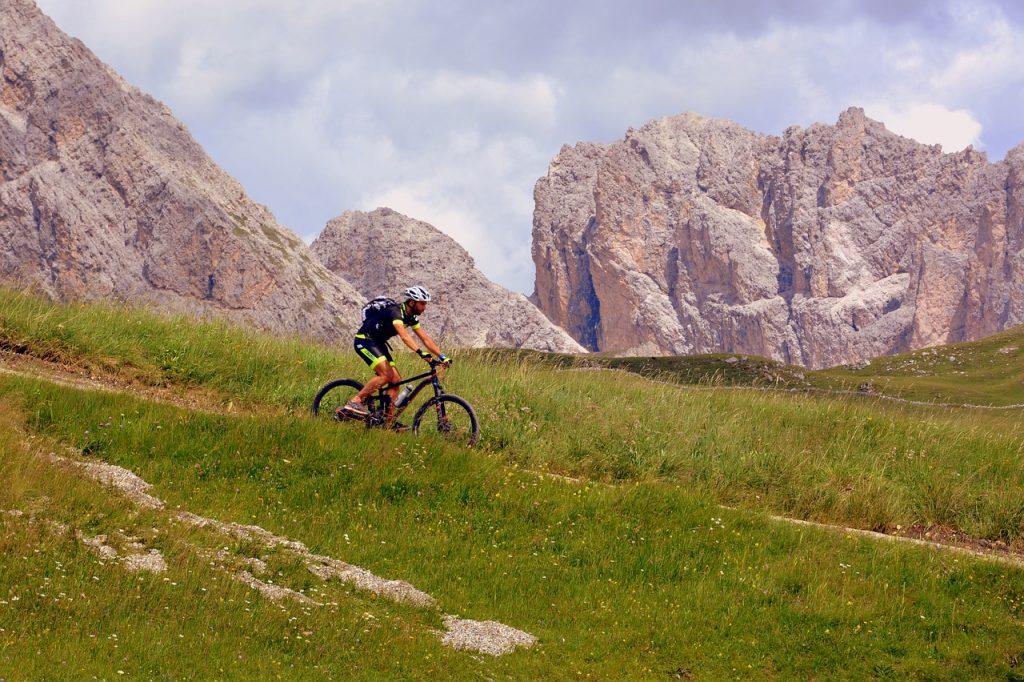 A man riding a mountain bike down a trail