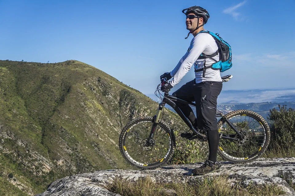 A man riding a mountain bike with a suspension fork