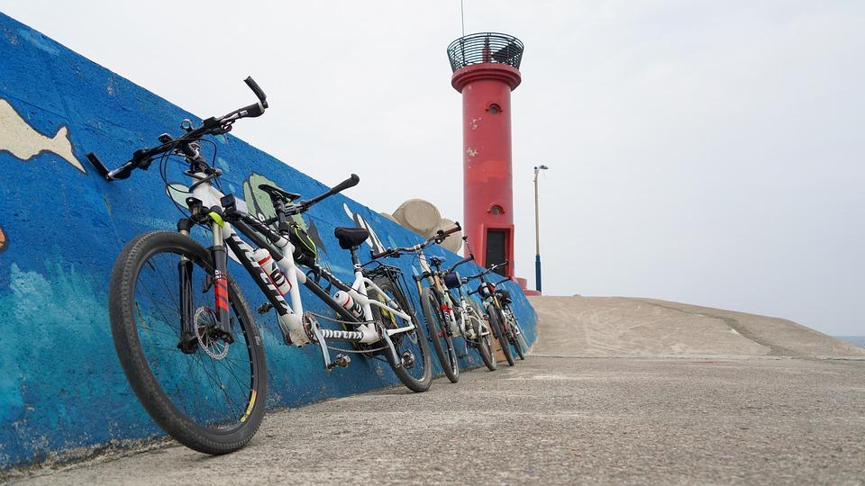 three tandem bikes at the beach
