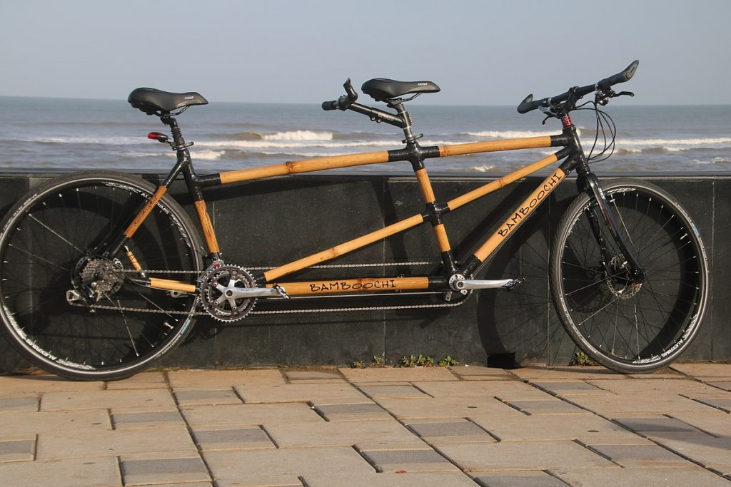 A tandem bicycle made from bamboo