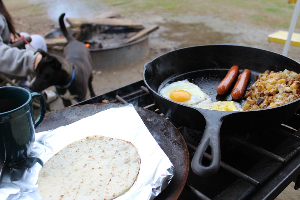 cooking a delicious breakfast at camp