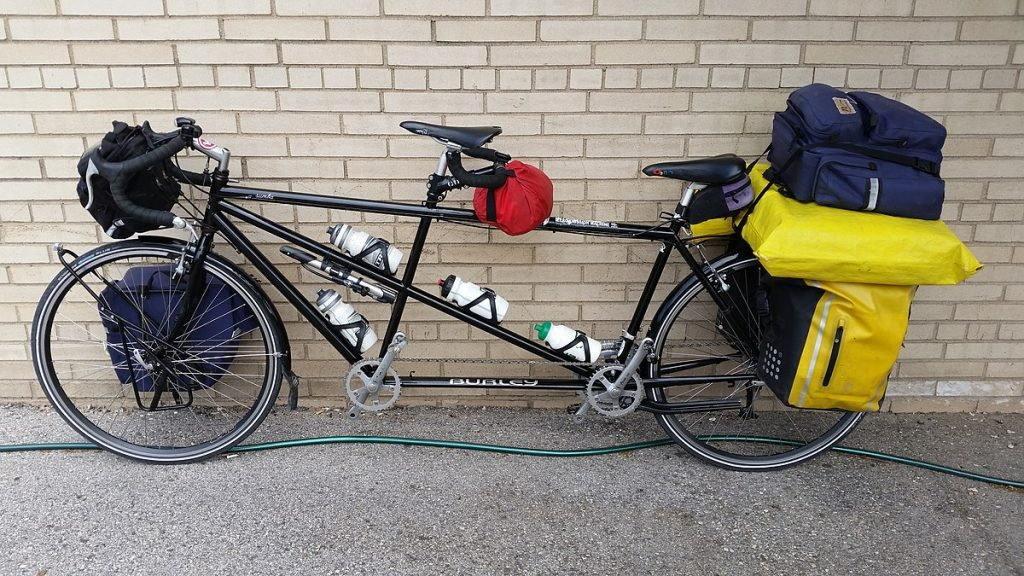 a tandem bicycle that is loaded for touring
