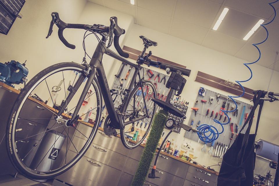 A bike being assembled on a bike stand at a bike shop